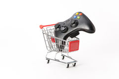 Caddy for shopping with game pad Royalty Free Stock Image