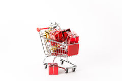 Caddy for shopping with gift Royalty Free Stock Photos