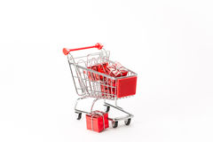 Caddy for shopping with gift Royalty Free Stock Photography