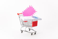 Caddy for shopping with money stack Stock Images