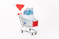 Caddy for shopping with money stack Royalty Free Stock Photo