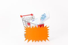 Caddy for shopping with money stack Royalty Free Stock Image