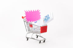Caddy for shopping with money stack Stock Photography