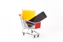 Caddy for shopping with smartphone Stock Photo