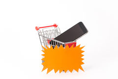 Caddy for shopping with smartphone Stock Photography