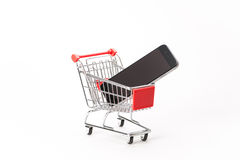 Caddy for shopping with smartphone Stock Images
