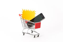 Caddy for shopping with smartphone Royalty Free Stock Photography