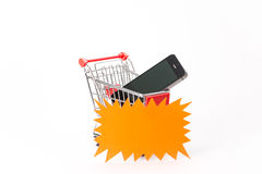 Caddy for shopping with smartphone Royalty Free Stock Photos