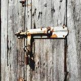 Cadeado e porta de madeira Fotografia de Stock