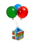 Cadeau avec des ballons Photographie stock libre de droits