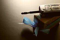 Cadeau de clé de voiture d'argent Photographie stock