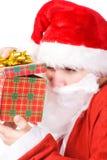 cadeau de Claus de cadre regardant Santa Photos libres de droits