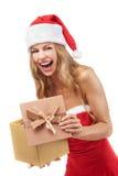Cadeau de fixation de femme de Noël heureux Image libre de droits