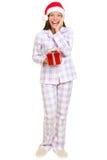 Cadeau de fixation de femme de Santa de matin de Noël Photos stock