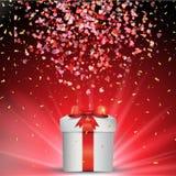 Cadeau de jour du ` s de Valentine avec les confettis en baisse Photos stock
