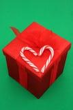 Cadeau de Noël de canne de sucrerie Images libres de droits