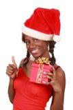 Cadeau de Noël de fixation de fille images stock