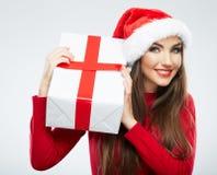 Cadeau de Noël de prise de portrait de femme de chapeau de Santa de Noël. Photographie stock