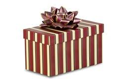 Cadeau de Noël rayé sur le fond blanc Photo stock