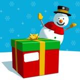 Cadeau de Noël et bonhomme de neige Photo stock