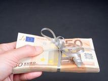 Cadeau financier Photographie stock libre de droits
