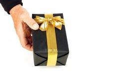 Cadeau gentil avec le ruban d'or image stock