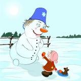Cadeau pour un bonhomme de neige Photo libre de droits