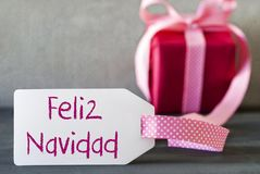 Cadeau rose, label, Feliz Navidad Means Merry Christmas photos stock