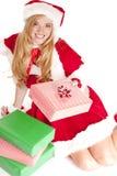 Cadeau se reposant de main de Mme Santa Image stock