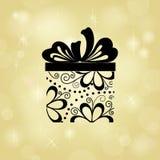 Cadeau sur le fond d'or Image libre de droits