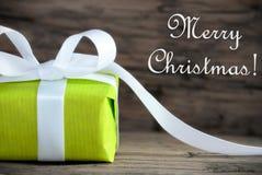 Cadeau vert avec le Joyeux Noël photos stock