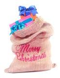 Cadeaux colorés de Noël dans le sac à Santa Photos libres de droits
