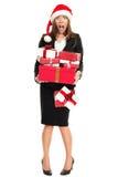 Cadeaux d'achats de femme de tension de Noël Photographie stock