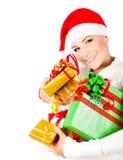 Cadeaux heureux de Noël de fixation de fille de Santa Image libre de droits