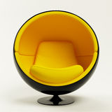 Cadeira amarela moderna da esfera isolada no branco Fotografia de Stock Royalty Free