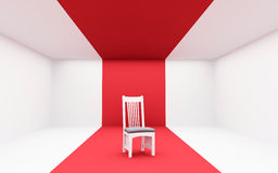 Cadeira branca no vermelho Fotografia de Stock Royalty Free