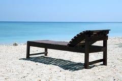Cadeira da lona na praia tropical Imagem de Stock Royalty Free