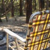 Cadeira de acampamento Fotografia de Stock Royalty Free