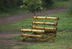 Cadeira de bambu no jardim imagem de stock royalty free