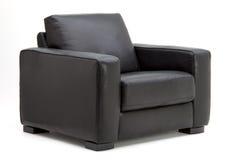 Cadeira de couro do braço Imagens de Stock