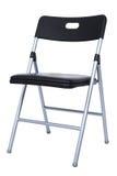 Cadeira de dobradura preta e de prata sobre o branco foto de stock