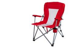 Cadeira de dobramento vermelha para acampar ou pescar, em um fundo branco, o isolado fotografia de stock