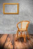 Cadeira de madeira com frame de retrato Imagem de Stock Royalty Free
