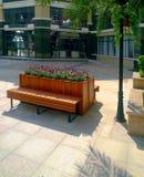 Cadeira de madeira no jardim Imagens de Stock