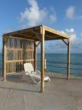 Cadeira de plataforma na doca em Guadalupe Fotografia de Stock Royalty Free