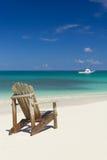 Cadeira de praia na areia Fotografia de Stock Royalty Free