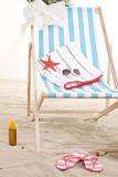 Cadeira de praia na areia Fotos de Stock Royalty Free