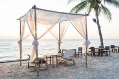 Cadeira de praia na praia Foto de Stock