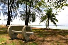 A cadeira de praia na praia Imagens de Stock Royalty Free