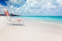 Cadeira de praia no louro da benevolência Fotografia de Stock
